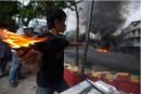 esercito delle camicie rosse dimostrano contro premier AbhisitVejjajiva