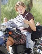 lettrice in motorino