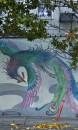 Un dipinto sulla parete di una strada a Chinatown